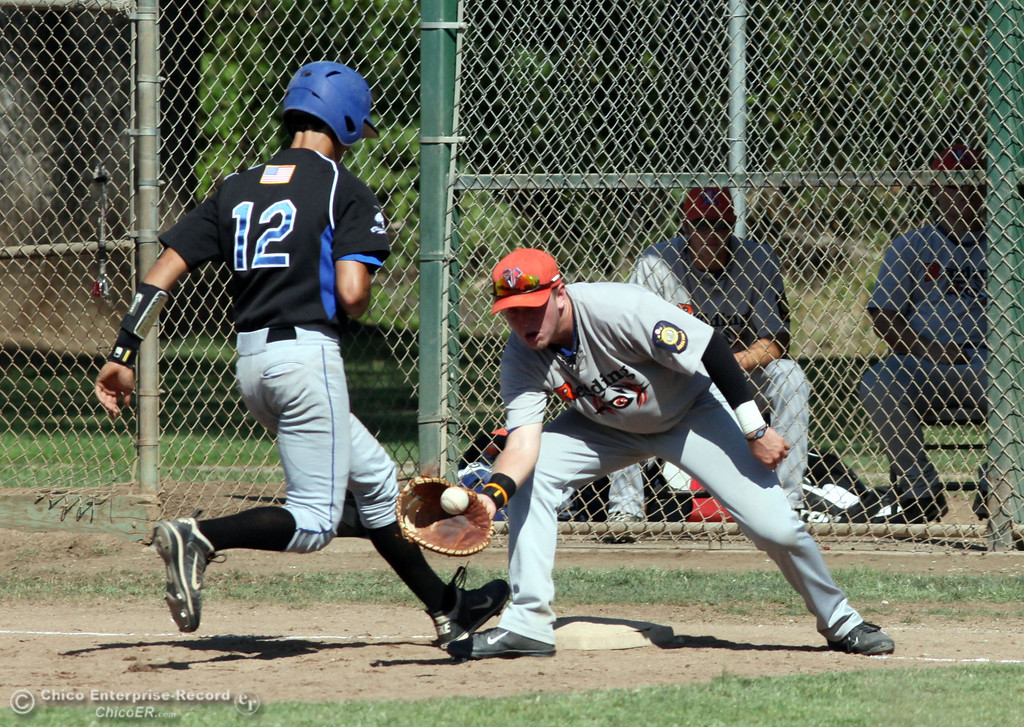 . Chico Nuts\' #12 Michael Sanderson (left) leaps back to first base safely in a pick off attempt against Redding Tigers\' #7 Carson Parks (right) in the top of the fourth inning during their American Legion baseball game at Doryland field Friday, July 19, 2013 in Chico, Calif.  (Jason Halley/Chico Enterprise-Record)
