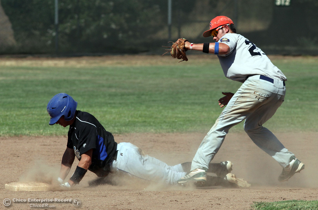. Chico Nuts\' #7 Ryan Souza (left) slides in late to second base against Redding Tigers\' #23 Austin LaBue (right) in the top of the third inning during their American Legion baseball game at Doryland field Friday, July 19, 2013 in Chico, Calif.  (Jason Halley/Chico Enterprise-Record)