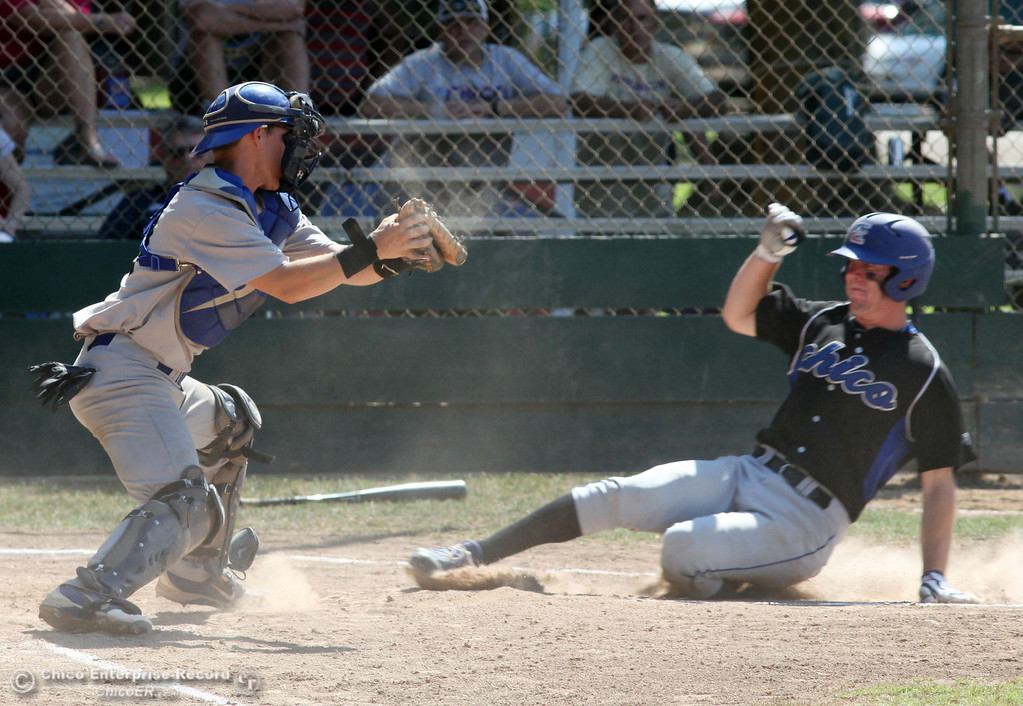 . Chico Nuts\' #20 Jackson Murphy (right) slides in late to home plate against Redding Tigers\' #13 Franklin Olson (left) who makes the tag in the top of the second inning during their American Legion baseball game at Doryland field Friday, July 19, 2013 in Chico, Calif.  (Jason Halley/Chico Enterprise-Record)