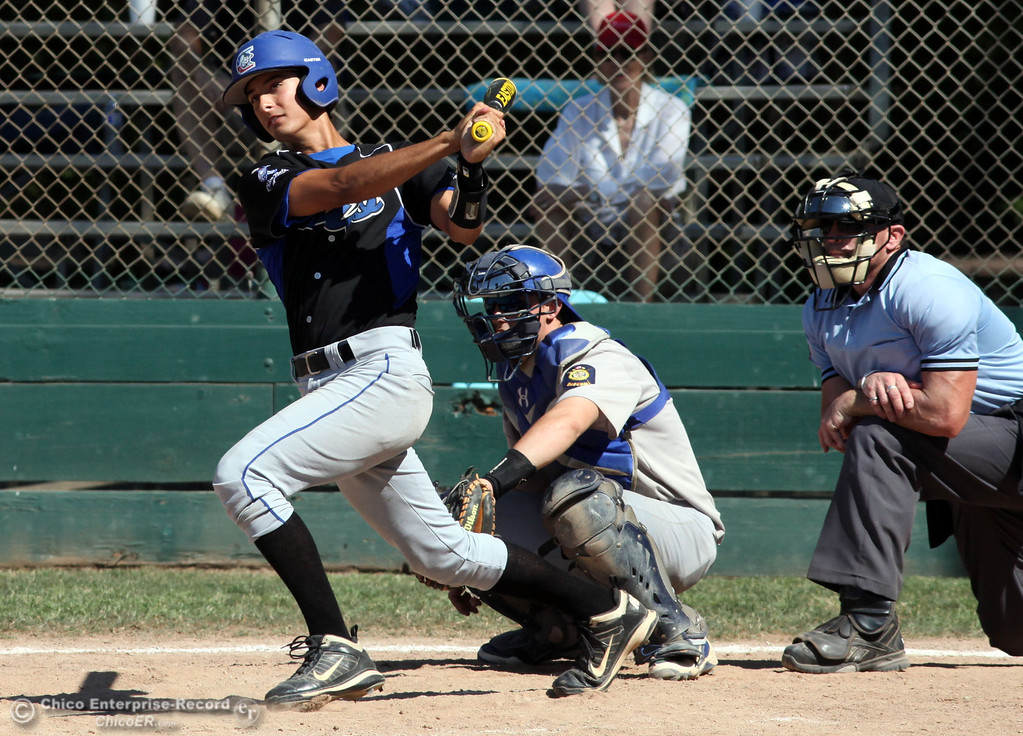 . Chico Nuts\' #12 Michael Sanderson knocks a single against Redding Tigers in the top of the fourth inning during their American Legion baseball game at Doryland field Friday, July 19, 2013 in Chico, Calif.  (Jason Halley/Chico Enterprise-Record)