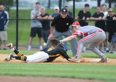 (Jack Haley/ for Messenger Post Media) Casey Saucke of Greece Athena beats a throw back to first as Canandaigua's Tristan Tyndall waits for the ball.