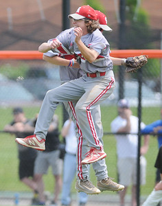 (Jack Haley/ for Messenger Post Media) Canandaigua pitcher Michael Sculli and first baseman TRistan Tyndall celebrate after a double play ends the game and gives the Braves the Class A1 title.