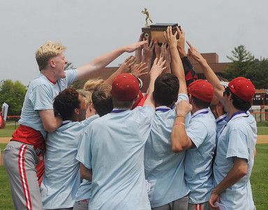 (Jack Haley/ for Messenger Post Media) The Canandaigua Braves celebrate with the Section Five Class A1 championships trophy after defeating top seeded Greece Athena 3-0 on Saturday at RIT.