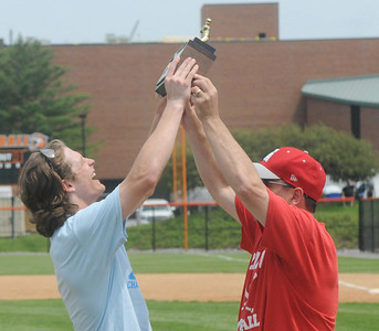 (Jack Haley/ for Messenger Post Media) Tournament MVP Michael Sculli takes the trophy from Canandaigua coach Dale Werth after the Braves won their fourth straight sectional title after blanking Greece Athena on Saturday 3-0.