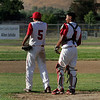 Lindsay High School pitcher Julian Gonzalez (5) and catcher Israel Uribe (4) await the rest of their team to celebrate a win over Corcoran High School on May 2, 2013.