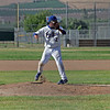 Corcoran pitcher Jacob Gamez checks the runner on first against Lindsay on May 2, 2013.