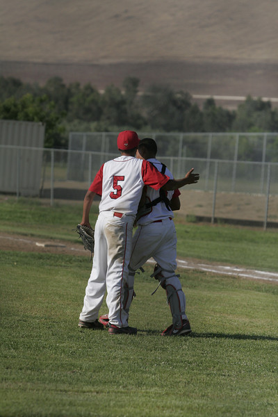 Lindsay HS pitcher Julian Gonzalez pat catcher Israel Uribe on the back after winning against Corcoran on May 2, 2013.