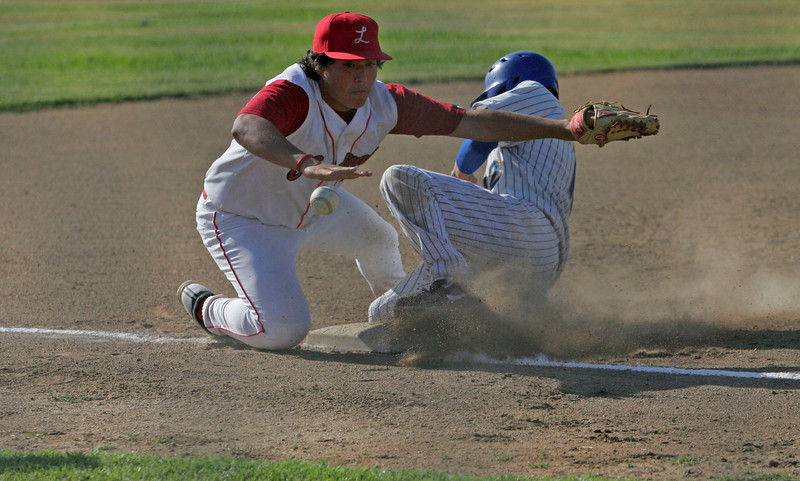 Lindsay Cardinal Marcus Nunez keeps his eye on the baseball as Corcoran Panther Jacob Gamez steals third on May 2, 2013.
