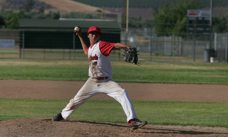 Lindsay pitcher Julian Gonzalez wind up for a pitch against Corcoran on Thursday, May 2, 2013.