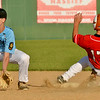 WARREN  DILLAWAY | Star Beacon<br /> Shane Gibson, of the Cowle Post 151 15 and under Bruisers, waits for the ball As Munson's Joey Mongelluzzi arrives safely at second base on Tuesday during junior legion action at Havens Complex in Jefferson.