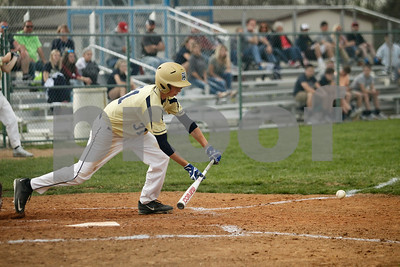 Tri-West  High School infielder Levi Jackson  (31) lays down the sacrifice bunt during the  game between Crawfordsville vs Tri-West at  Tri-West High School in Lizton,IN. (Jeff Brown/Flyer Photo)