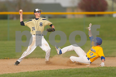 Tri-West  High School infielder Levi Jackson  (31) tires to turn the double play after forcing out Crawfordsville High School senior Kaile Wendelin  (12) at second during the  game between Crawfordsville vs Tri-West at  Tri-West High School in Lizton,IN. (Jeff Brown/Flyer Photo)