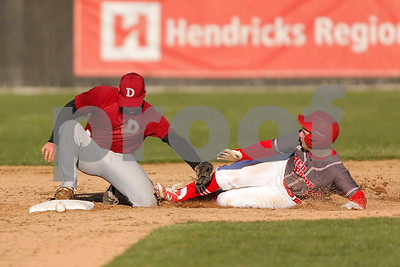 Plainfield High School outfielder Tanner Penry (10) slides safely into second as Danville High School second baseman Collin Rutan (5) dropped the ball during the game between Danville vs Plainfield at  Plainfield High School in Plainfield,IN. (Jeff Brown/Flyer Photo)
