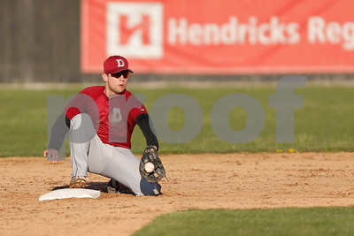 Danville High School second baseman Collin Rutan (5) has the throw hit the back of his glove during the game between Danville vs Plainfield at  Plainfield High School in Plainfield,IN. (Jeff Brown/Flyer Photo)