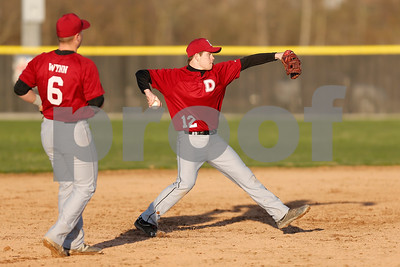 Danville High School shortstop Reece Jensen (12) fires to first for the out during the game between Danville vs Plainfield at  Plainfield High School in Plainfield,IN. (Jeff Brown/Flyer Photo)