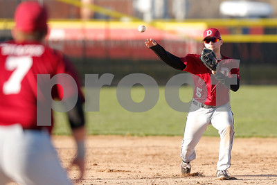 Danville High School second baseman Collin Rutan (5) makes the throw to Danville High School first baseman Ethan Shafer (7) for the out during the game between Danville vs Plainfield at  Plainfield High School in Plainfield,IN. (Jeff Brown/Flyer Photo)