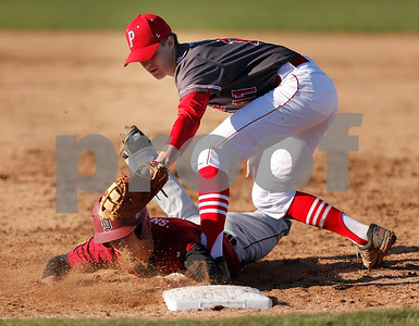 Plainfield High School first baseman Payton Leath  (11) puts the tag on Danville High School outfielder Dylan Snider (4) to complete the pick off during the game between Danville vs Plainfield at  Plainfield High School in Plainfield,IN. (Jeff Brown/Flyer Photo)