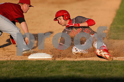 Plainfield High School outfielder Gavin Jacobs  (13) slides safely into third avoiding the tag of Danville High School third baseman Jackson Wynn (6) during the game between Danville vs Plainfield at  Plainfield High School in Plainfield,IN. (Jeff Brown/Flyer Photo)