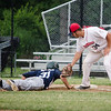 Wachusett Dirt Dawg's Angelo Navetta checks a runner back to first base during the game against the Worcester Bravehearts on Tuesday evening at Doyle Field. SENTINEL & ENTERPRISE  / Ashley Green