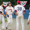 Dirt Dawgs' Ryan Solomon is congratulated by teammates after hitting a home run during the game against Brockton Rox at Doyle Field on Tuesday evening. SENTINEL & ENTERPRISE / Ashley Green