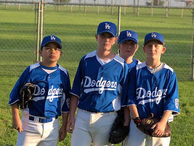 Adam Orosco, Preston Boatwright, Noah Jeffery, and Travis Peterson playing for Deer Canyon Little League Dodgers.