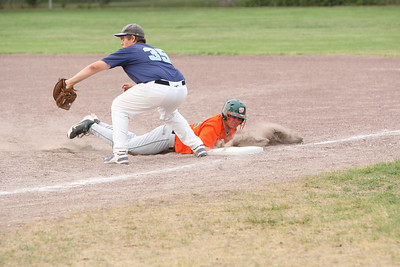 Jordan McCracken on first base tries to tag out Leighton Freeze on the Express.