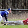 Fitchburg High School Baseball played Lunenburg High School at home on Monday mornng. LHS's third baseman Dawson Stacy get the throw just in time to tag out FHS's Darius Flowers during action in the game. SENTINEL & ENTERPRISE/JOHN LOVE