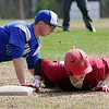 Fitchburg High School Baseball played Lunenburg High School at home on Monday mornng. Lunenburg's first baseman Jason Booth tries to tag out Fitchburg's James Descouteau as he dives back to first during action in the game. SENTINEL & ENTERPRISE/JOHN LOVE