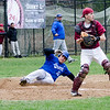 Leominster's Justin Robbins slides safely into home during the game against Fitchburg on Wednesday afternoon. SENTINEL & ENTERPRISE / Ashley Green