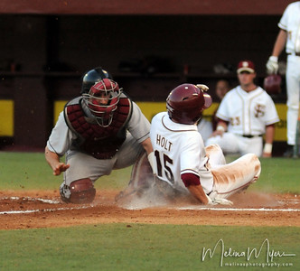 #15 Tyler Holt slides in safe to home plate at the Florida State vs. Virginia Tech Baseball game on May 1, 2009 in Tallahassee, FL.