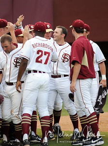 #6 Tommy Oravetz is met by teammates after a score at the Florida State vs. Grambling State baseball game held on May 14, 2009 in Tallahassee, Florida.