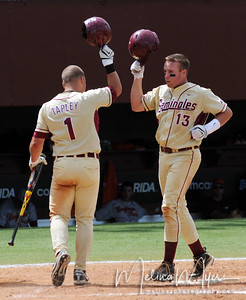 #1 Stuart Tapley congratulates #13 Jason Stidham for scoring a home run at the FSU vs. Virginia Tech Baseball Game held on May 3, 2009 at Dick Howser Stadium in Tallahassee, FL.