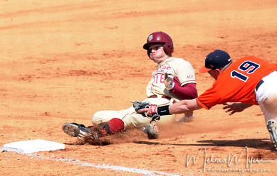 #16 Jayce Boyd slides in safe to third base during the University of Virginia and Florida State University Baseball match held on Sunday, March 14, 2010 in Tallahassee, Florida.