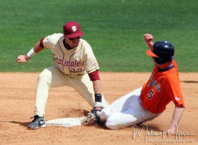 #38 Stephen Cardullo tags out a runner during the University of Virginia and Florida State University Baseball match held on Sunday, March 14, 2010 in Tallahassee, Florida.