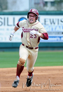 #23 James Ramsey runs to make it to third base during the University of Virginia and Florida State University Baseball match held on Sunday, March 14, 2010 in Tallahassee, Florida.