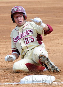 #23 James Ramsey slides in safe to third base during the University of Virginia and Florida State University Baseball match held on Sunday, March 14, 2010 in Tallahassee, Florida.