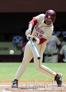 #32 Sherman Johnson hits the ball during the University of Virginia and Florida State University Baseball match held on Sunday, March 14, 2010 in Tallahassee, Florida.