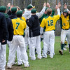 Teammates congratulate Fitchburg State's Nathan Littman after scoring a run during the game against Framingham State on Thursday afternoon. SENTINEL & ENTERPRISE / Ashley Green