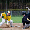 Fitchburg States's Andrew Mooney tags the Framingham State baserunner out during the game on Thursday afternoon. SENTINEL & ENTERPRISE / Ashley Green