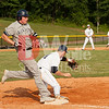 Brandon Grove (24) keeps his foot on the first base bag while catching the throw from center field forcing Sam Few of the Alexandria Aces out at first.   If the throw has been a moment later, Sam would have been safe at first.