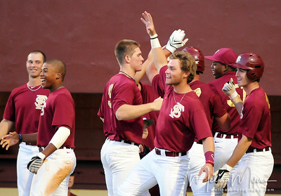 The Garnet team celebrates a run at the annual Garnet and Gold Baseball game held on October 22, 2010 at Dick Howser Stadium.