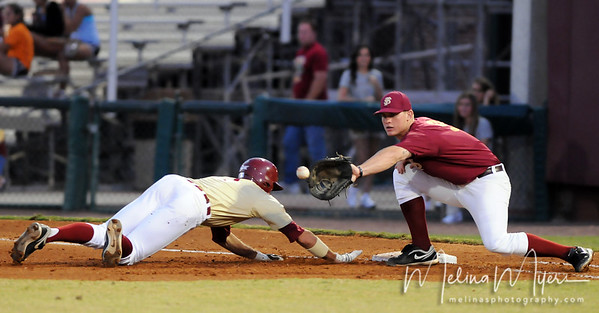 Sean Gilmartin (3) dives back to tag up at first base and avoid a tag from first baseman Stephen McGee (9) at the annual Garnet and Gold Baseball game held on October 22, 2010 at Dick Howser Stadium.