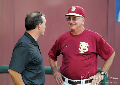 Coach Mike Martin (R) talks to Head Football Coach Jimbo Fisher (L) at the annual Garnet and Gold Baseball game held on October 22, 2010 at Dick Howser Stadium.