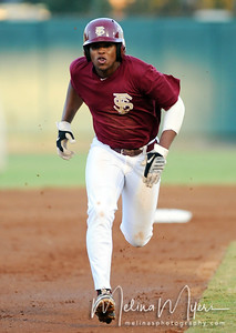 Sherman Johnson (32) runs down the baseline towards 3rd base at the annual Garnet and Gold Baseball game held on October 22, 2010 at Dick Howser Stadium.