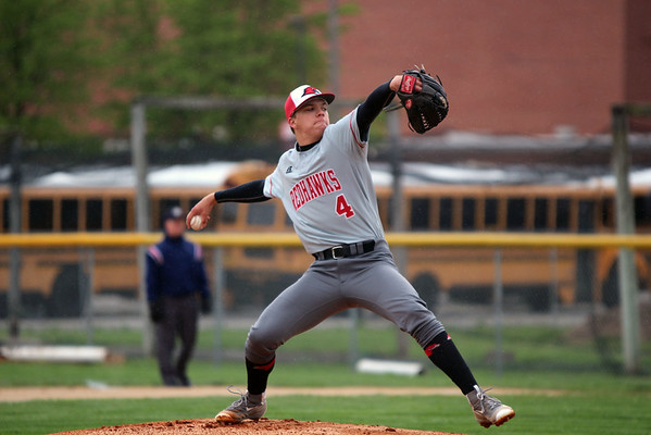 GREG KEIM | THE GOSHEN NEWS<br /> Senior James Paetkau delivers a pitch for the Goshen RedHawks in an NLC baseball game against the Northridge Raiders Wednesday night in Goshen. Paetkau scattered five hits in the complete game victory.
