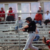 GREG KEIM | THE GOSHEN NEWS<br /> Senior Chad Sellers slaps a run-scoring single in the first inning of the NorthWood Panthers in an NLC high school baseball contest Wednesday night with the Goshen RedHawks at Phend Field in Goshen.
