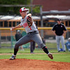 GREG KEIM | THE GOSHEN NEWS<br /> Sophomore pitcher Joseph Pebbles fires a pitch for the Goshen RedHawks in an NLC high school baseball game Wednesday night with the NorthWood Panthers at Phend Field in Goshen.