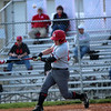 GREG KEIM | THE GOSHEN NEWS<br /> Sophomore Robby Riegsecker takes a cut for the Goshen RedHawks in an NLC high school baseball game Wednesday night with the NorthWood Panthers at Phend Field in Goshen. Riegsecker slugged two home runs in the game, including the game-winner in the sixth inning.