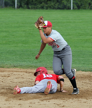 STEPHEN BROOKS | THE GOSHEN NEWS<br /> Goshen senior Tito Garcia lifts his glove to show the ball after tagging a Plymouth base-runner out at second base during Wednesday's game at Phend Field in Goshen. Goshen lost 8-6.
