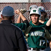 SAM HOUSEHOLDER | THE GOSHEN NEWS<br /> Wawasee senior Drew Anderson celebrates with teammates and coaches after hitting a home run against Goshen Friday.
